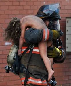 Fire fighter saving naked child