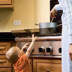 Child touching stove eye
